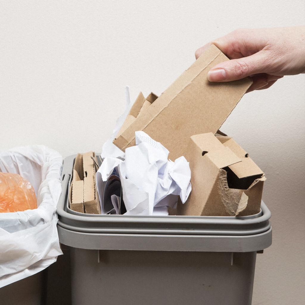 Waste bin with old cardboard in