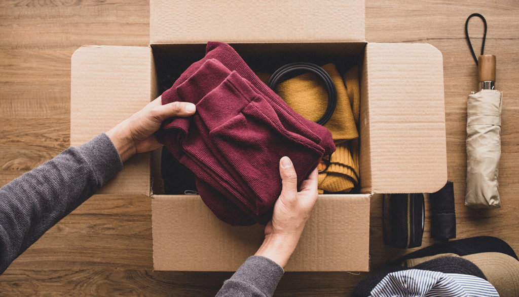 Person sharing clothes in a box