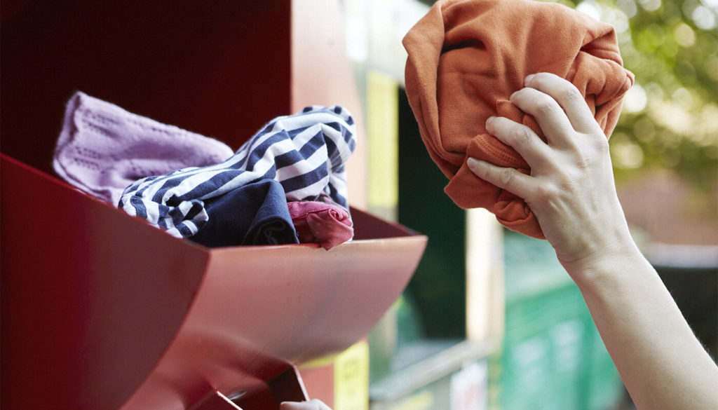 Clothes being put into a clothing bank