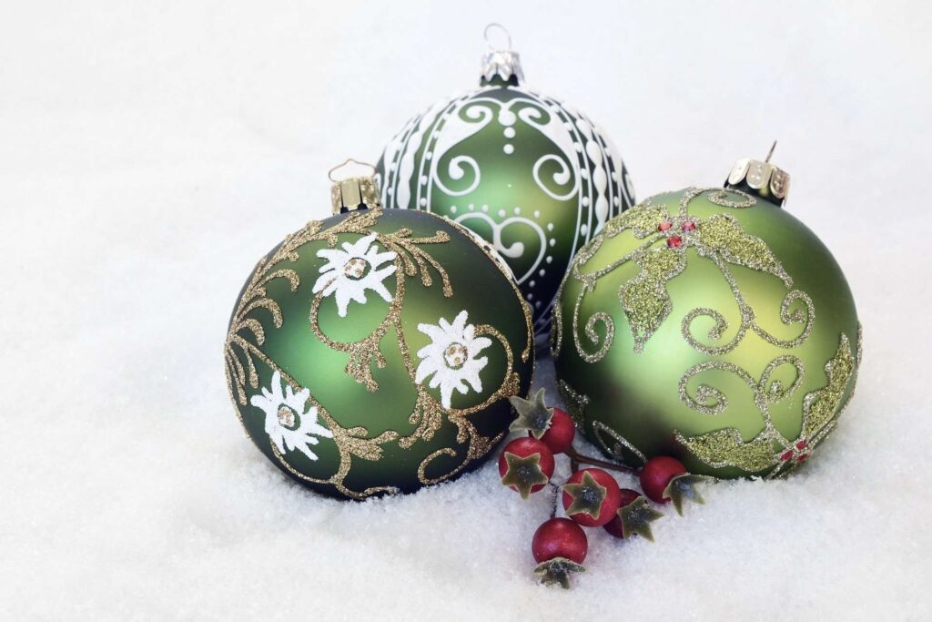 three green baubles lying on snow