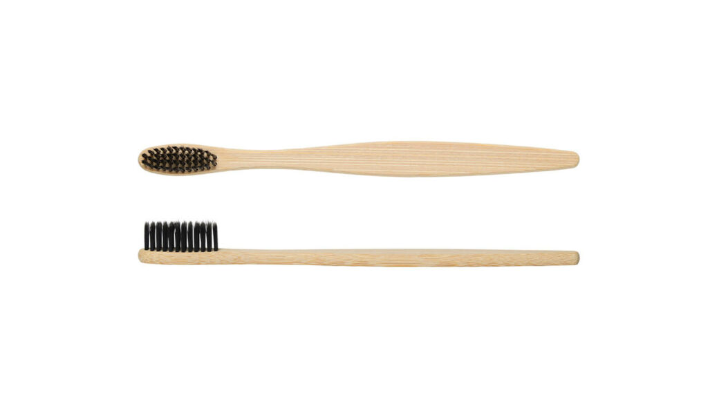 two bamboo toothbrushes with black bristles. One side-on and one front-on