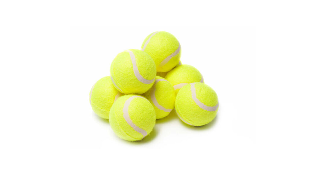 an image of a small pile of bright yellow tennis balls